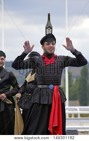 PYATIGORSK,RUSSIA - SEPTEMBER 25,2016:Unknown member of the popular band ''Zolotoe runo'' it shows a trick with a bottle, hippodrome in Pyatigorsk,Caucasus, Russia on September 25,2016.