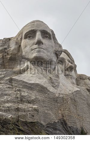 The faces of George Washington and Thomas Jefferson on Mount Rushmore.