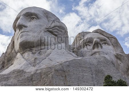 The face of George Washington and Thomas Jefferson on Mount Rushmore.