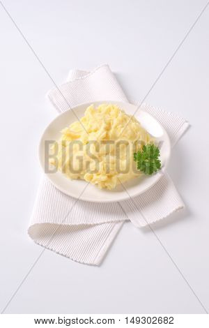 plate of mashed potatoes puree on white place mat