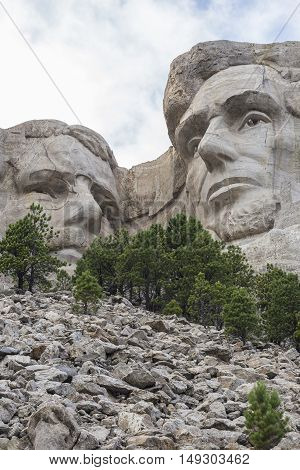 The faces of Theodore Roosevelt and Abraham Lincoln on Mount Rushmore.