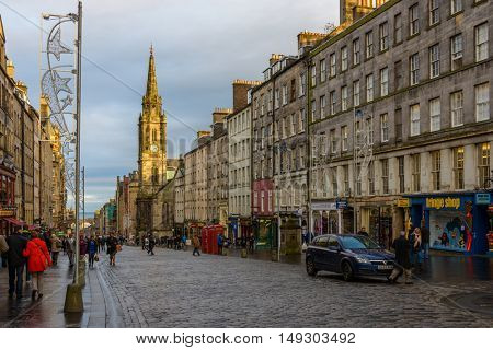 EDINBURGH, SCOTLAND - CIRCA NOVEMBER 2012: The Royal Mile at sunset and Tron Kirk former church.