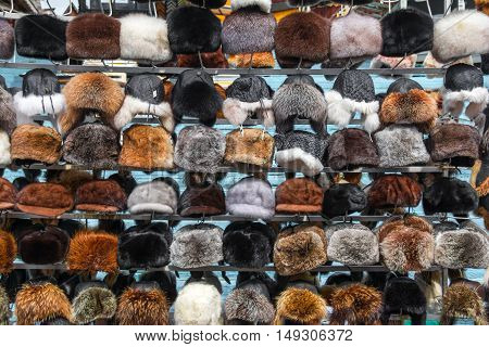 Fur hats. Sale of winter fur hats