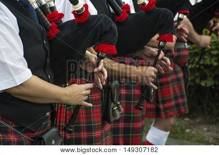 Hands of Scotlands people play the bagpipes