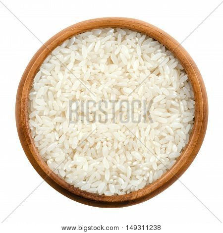 Sushi rice in a wooden bowl on white background. White short-grain Japanese rice, the seeds of the grass Oryza sativa, also known as Asian rice. Cereal grain and staple food. Isolated macro photo.