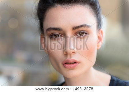 close up of the unwind face of a woman