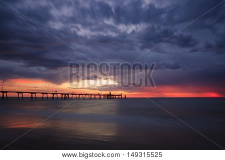 Glenelg Jetty in Adelaide, South Australia, Australia during sunset