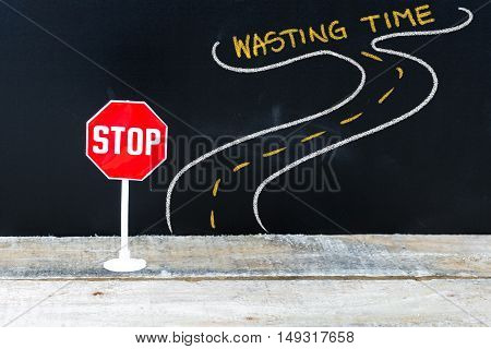 Mini Stop Sign On The Road To Wasting Time