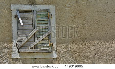 A window in an old derelict building in the historic Montenegrin town of Kotor.