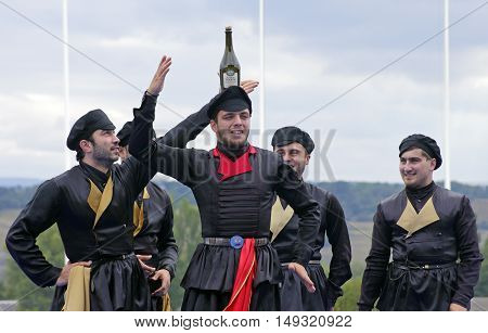 PYATIGORSK,RUSSIA - SEPTEMBER 25,2016:Unknown member of the popular band ''Zolotoe runo'' it shows a trick with a bottle,hippodrome in Pyatigorsk,Caucasus,Russia on September 25,2016.