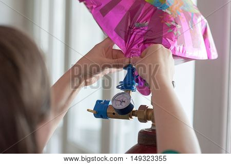 girl in the process of filling gas Helium foil products