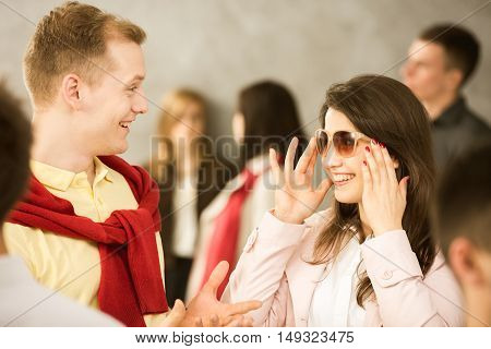 Young couple on the street trying the sunglasses on
