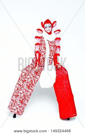 Female clown in a vintage style with a typical makeup on white background
