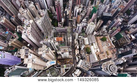 Top view aerial photo from flying drone of a Hong Kong Global City with advanced buildings transportation energy power infrastructure. Financial and business centers in developed China town