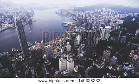 Aerial photo from flying drone of a Hong Kong advanced city view with most popular financial and business centers. Well developed infrastructure of buildings construction and urban transportation