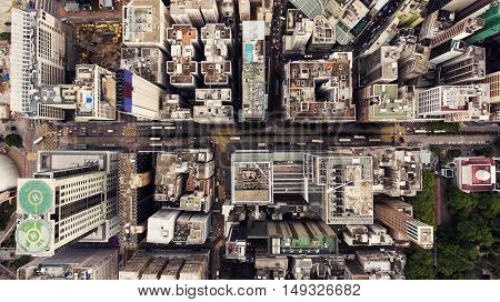 Top view aerial photo from flying drone of a Hong Kong Global City with development buildings transportation energy power infrastructure. Financial and business centers in developed China town