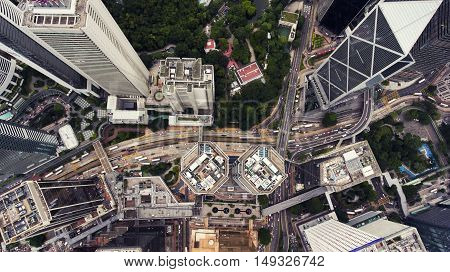 Top view aerial photo of China megapolis city with development transport infrastructure as roads highways streets and bus stations. Office skyscrapers of Hong Kong international financial centres