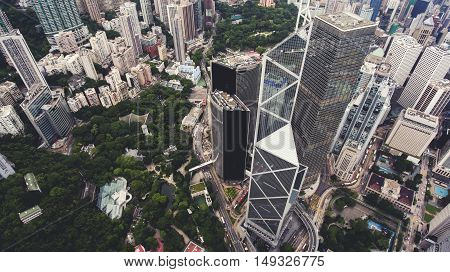 Top view aerial photo from drone of big metropolis city with development urban and transportation infrastructure. Office skyscrapers of Hong Kong world's leading international financial centres