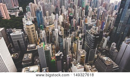 Aerial photo from flying drone of a business district in China with many tall skyscrapers. Top view exterior of office buildings with modern design in developed metropolitan city. Website background