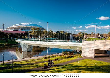 Adelaide Australia - September 11 2016: Adelaide Oval and foot bridge viewed across Elder Park on a bright day