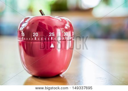 25 Minutes - Kitchen Egg Timer In Apple Shape On Wooden Table