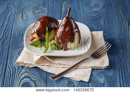 Delicious Poached Pears With Chocolate Syrup Ready To Serve