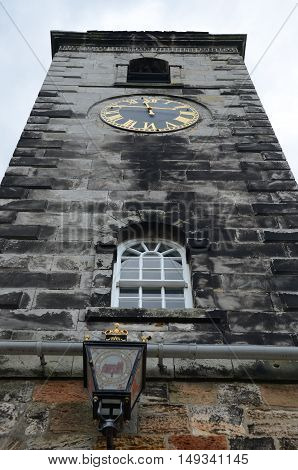 A view of the old stone clock tower on the town house in Culross
