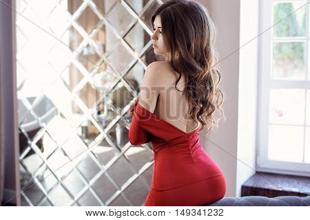 Beautiful Sexy Lady In Elegant Red Dress. Close Up Fashion Portrait Of Model Indoors. Beauty Brunett