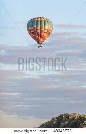 BLOEMFONTEIN SOUTH AFRICA - JULY 16 2016: Unidentified people in a hot air baloon on a cold winters morning over Bloemfontein