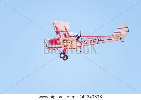 BLOEMFONTEIN SOUTH AFRICA - JULY 16 2016: An unidentified pilot in a Tiger Moth in a public display at the Tempe Airport at Bloemfontein