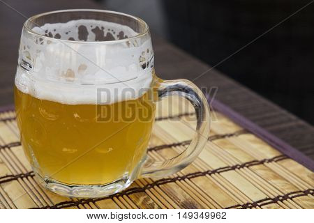 Glass Mug Of Unfiltered Weizen Beer On Table