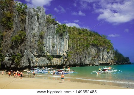 PALAWAN PHILIPPINES FEBRAURY 11 2016, Boats on the beach near the cave entrance of Puerto Princesa subterranean underground river - One of the 7 New Wonders of Nature