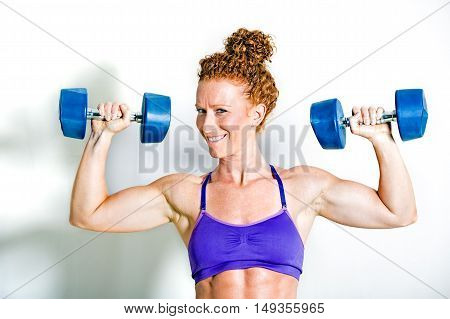 Fit Athlete Holding Up Dumbbell Weights