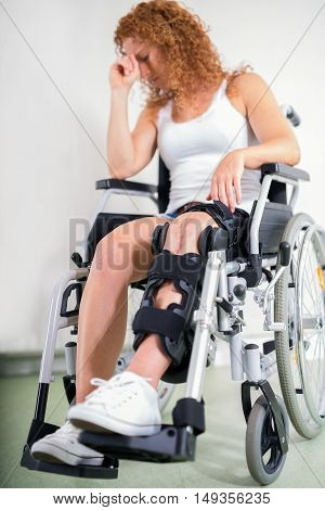 Dejected Woman With Her Knee In A Brace