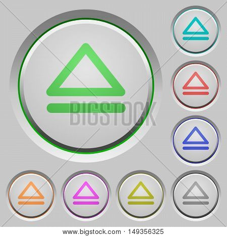 Set of color media eject sunk push buttons.