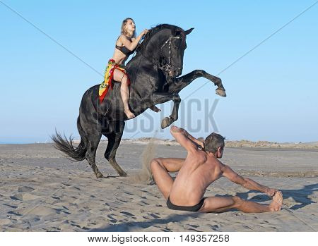 horsewoman and her horse and yogi on the beach