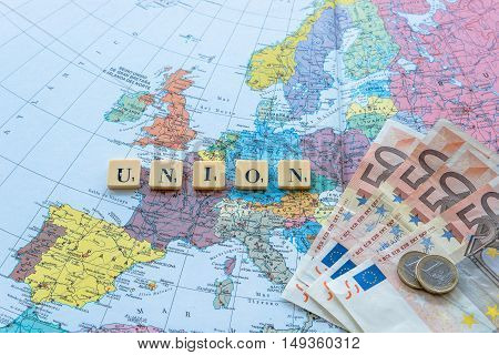 London UK - June 12 2016: Union word with euro money on european map. The United Kingdom European Union membership referendum on 23 June 2016
