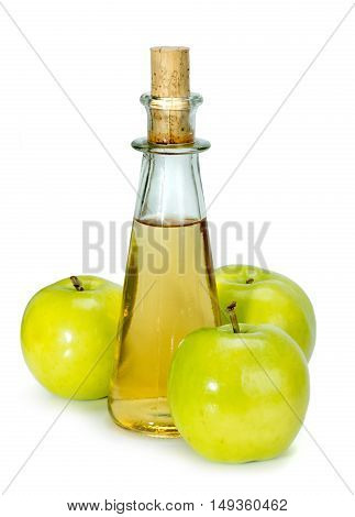 Apple Cider Vinegar In A Glass Vessel And Green Apples