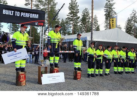 JAMSA, FINLAND - SEPTEMBER 2, 2016: Winner Jari Sarajarvi 2nd left with other finalists in the prize ceremony of the Finnish Championships in Log Loading 2016 held at FinnMETKO 2016.