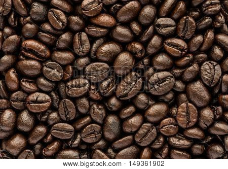 close up background and texture of brown coffee beans