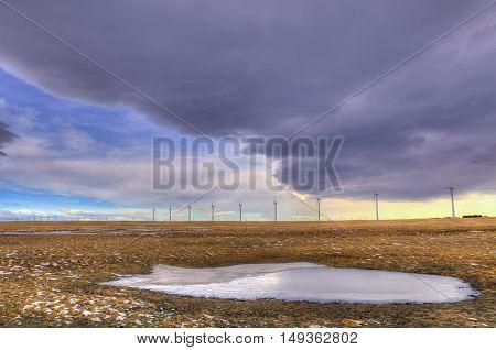 Windfarm in the prairies of Alberta Canada in winter