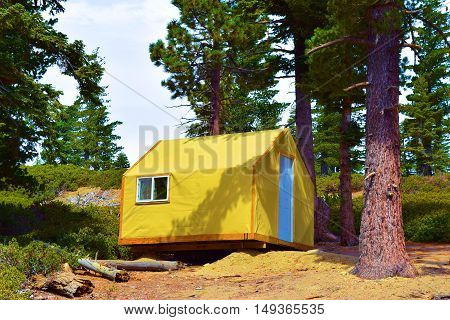 Modern rustic tent cabin where people can enjoy a comfortable camping experience taken at a Pine Forest in Mt Baldy, CA
