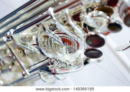 Shiny alto saxophone with detailed view of keys