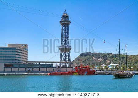 Barcelona Port: View of Port Vell with the Tower of Jaume I, part of World Trade Center, the cruise port, Teleferico Montjuic funicular and the Montjuic hill in the back - May 2 2016, Barcelona, Spain