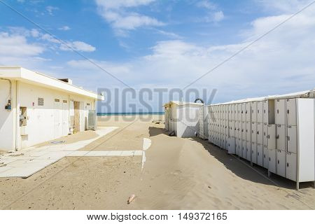 RIMINI,ITALY-APRIL 17,2015:bathhouse after this season on the beach in Rimini-Italy during a sunny day.