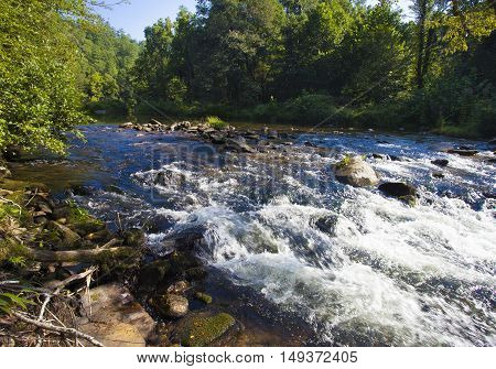 Water cascading over rocks in Wilson Creek in North Carolina