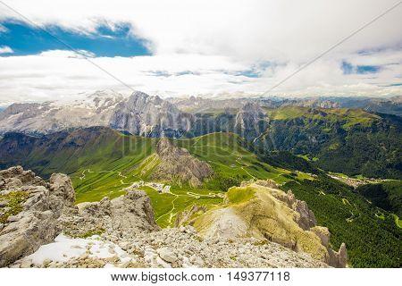 Pordoi pass mountain road and Marmolada mountain range seen from the Sass Pordoi plateau in Dolomites Italy Europe