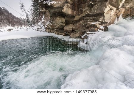Winter Waterfalls in the Carpathian Mountains on the river Prut. Yaremcha Ukraine.