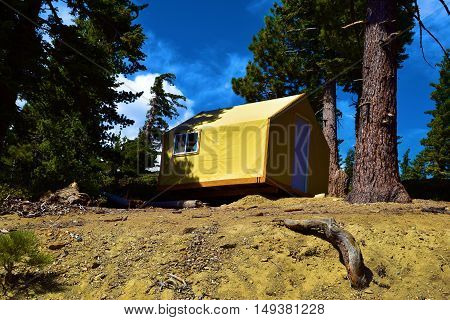Modern rustic style tent cabin where people can enjoy a comfortable camping experience taken at a Pine Forest in Mt Baldy, CA