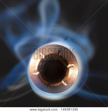 Bullet that appears to be coming at the camera with smoke behind